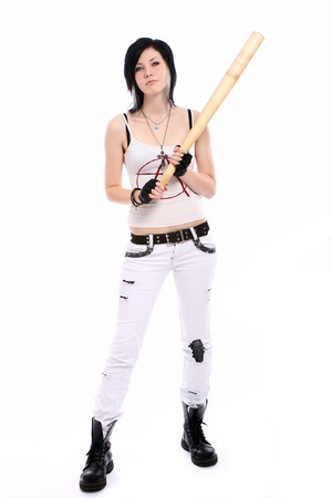 Young punk girl with baseball bat over white background