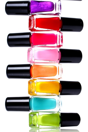 Colorful nail polish over white background photo