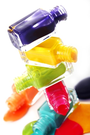 Bottles with spilled nail polish over white background Stock Photo - 11905598