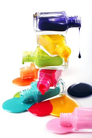 Bottles with spilled nail polish over white background Stock Photo - 11905596