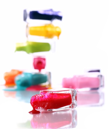 Bottles with spilled nail polish over white background Stock Photo - 11905422