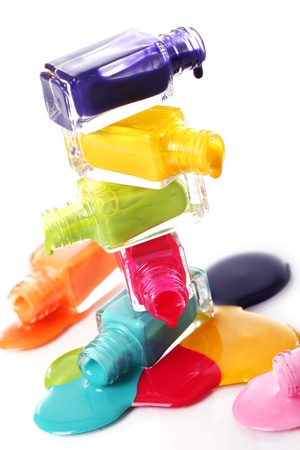 Bottles with spilled nail polish over white background Stock Photo - 11905636