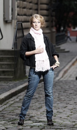 Young and beautiful woman on the city street photo