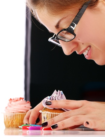Woman and tasty cupcake photo