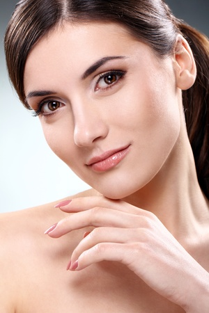 Young and beautiful brunette with clean face photo
