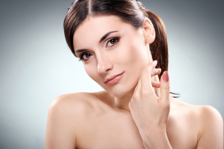 Young and beautiful brunette with clean face Stock Photo - 12010056