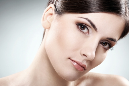 Young and beautiful brunette with clean face Stock Photo - 12010060