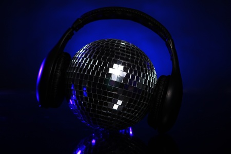 Shiny discoball with headphones on top photo