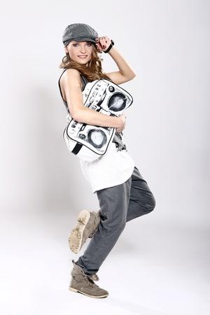 Fashion photo of stylish girl with handbag photo