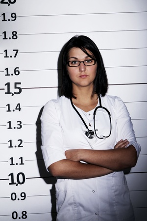 Young doctor over jail background photo