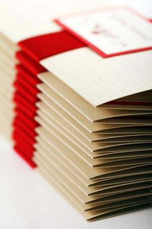 Gift envelopes with red bow isolated over white photo
