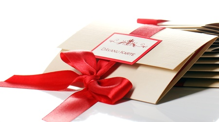 Gift envelopes with red bow isolated over white Stock Photo