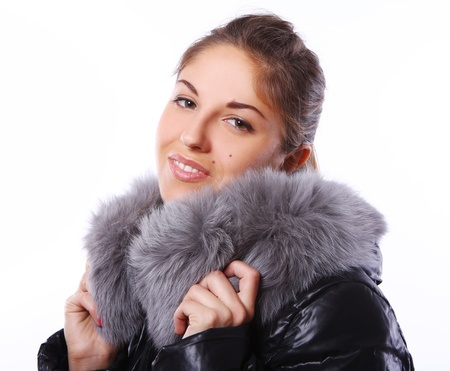 Beautiful woman in fur over white background photo