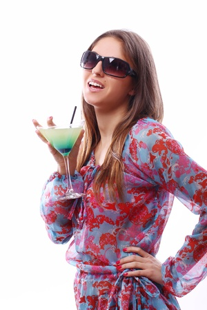 Happy woman with green cocktail over white background photo