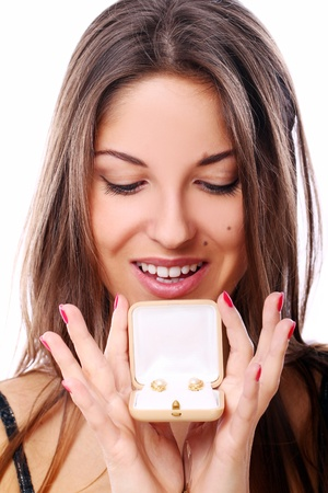 Happy woman with jewels in box  over white background photo