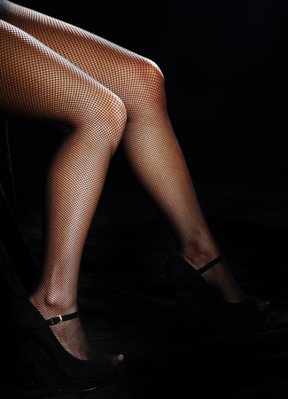 Beautiful female legs in black pantyhose Stock Photo - 11926639