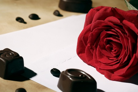Close up of Love letter and red rose photo