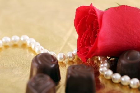Close up of red rose and chocolate candies Stock Photo - 12104171