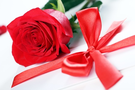 Close up of Red rose and holiday envelope photo