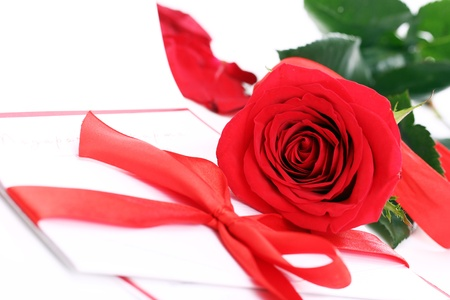 Close up of Red rose and holiday envelope
