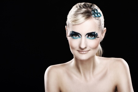 Beautiful blonde with artistic makeup over black background Stock Photo - 12189708
