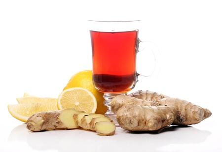 ginger plant: Hot tea with ginger and lemon over white background
