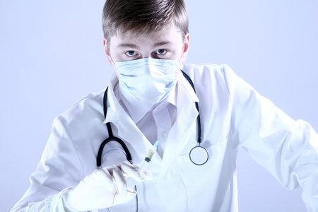 Doctor holding syringe in hand photo