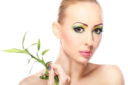 Beautiful blonde with artistic make- up and  bamboo leaves Stock Photo - 12221882