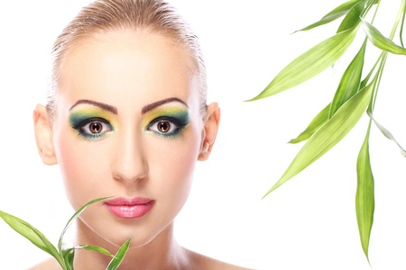 Beautiful blonde with artistic make- up and  bamboo leaves Stock Photo - 12221889