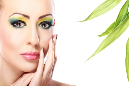 Beautiful blonde with artistic make- up and  bamboo leaves Stock Photo - 12221883