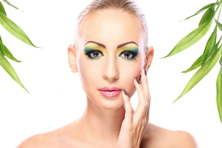 Beautiful blonde with artistic make- up and  bamboo leaves Stock Photo - 12221886