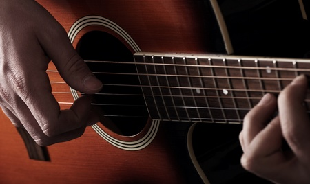 acoustic: Musician playing on acoustic guitar Stock Photo