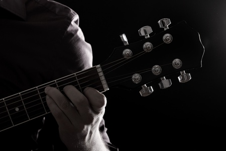 the blues: Musician playing on acoustic guitar Stock Photo