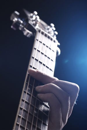 fretboard: Musician playing on acoustic guitar Stock Photo