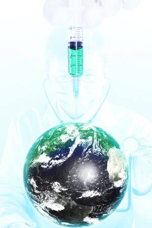 Earth with syringe and medic on background photo