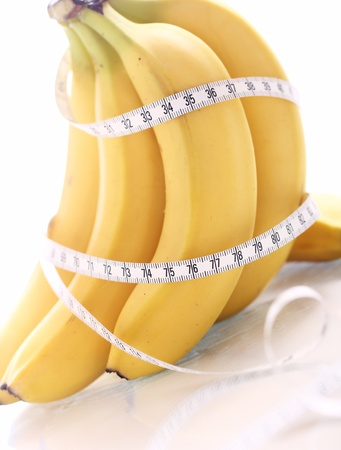 Close up of fresh bananas and measure tape Stock Photo - 12629136