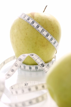 Close up of Green apples with measure tape Stock Photo - 12629119