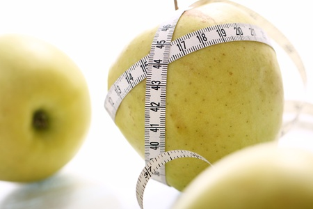 Close up of Green apples with measure tape Stock Photo - 12629371