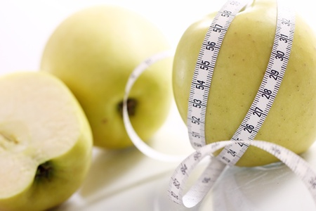 Close up of Green apples with measure tape Stock Photo - 12629359