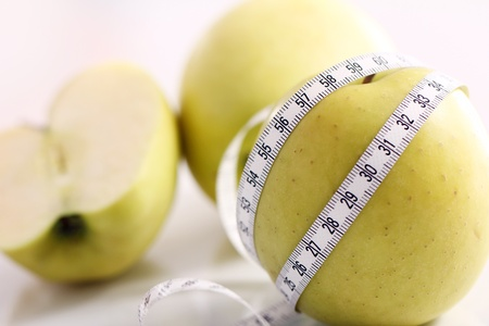 Close up of Green apples with measure tape Stock Photo - 12629456