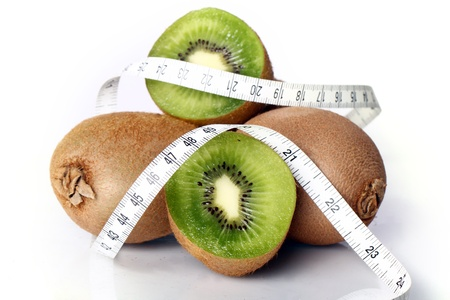 Close up of fresh kiwi and measure tape Stock Photo - 12629147