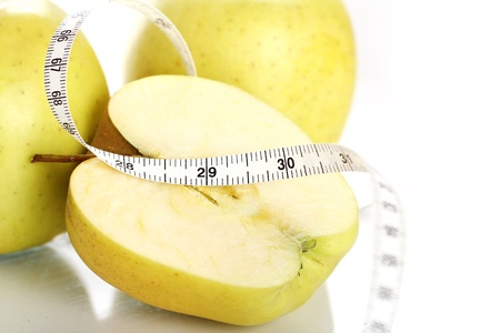 Close up of Green apples with measure tape Stock Photo - 12629145