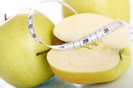 Close up of Green apples with measure tape Stock Photo - 12629455