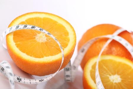 Close up of fresh orange and measure tape Stock Photo - 12629090