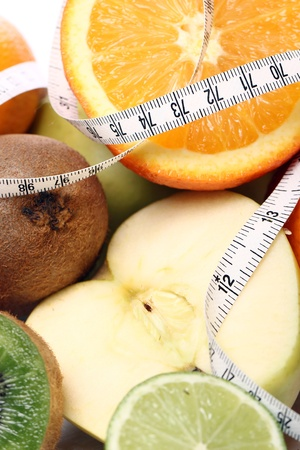 Close up fresh fruits and measure tape photo