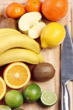 Fresh and colorful fruits on wooden board photo