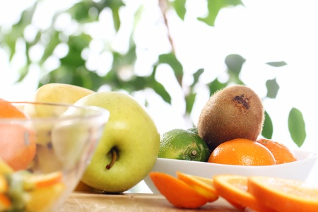 Different fresh fruits on the kitchen table Stock Photo - 12629135