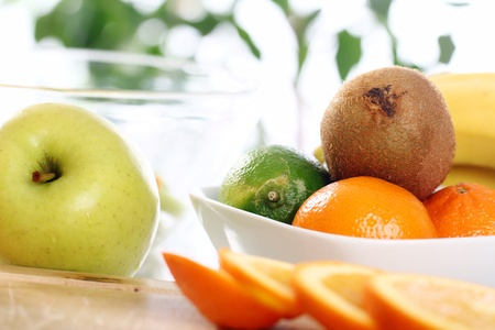 Different fresh fruits on the kitchen table Stock Photo - 12629505