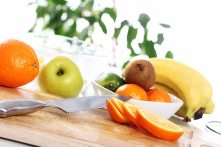Different fresh fruits on the kitchen table Stock Photo - 12629420
