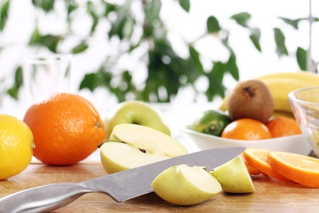 Different fresh fruits on the kitchen table photo